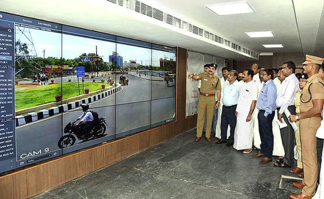 Commissioner of Police A. Amalraj explaining the monitoring system to MP P. Kumar and Collector K. Rajamani at the modern police control room in Tiruchi on Tuesday.