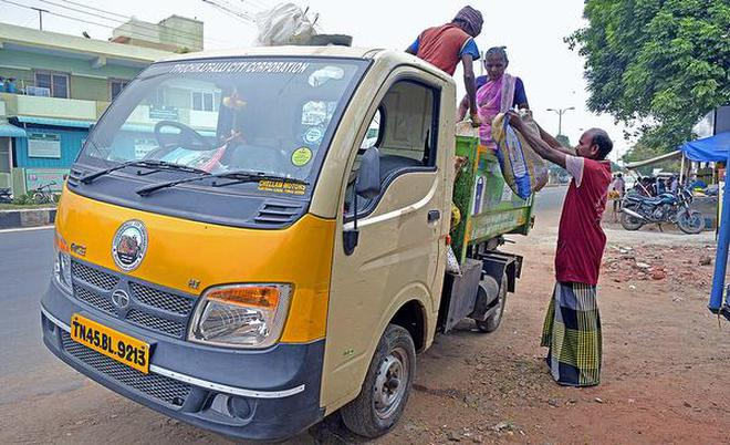 Corporation workers collecting waste using a light commercial vehicle in Tiruchi on Thursday.M. MoorthyM_Moorthy