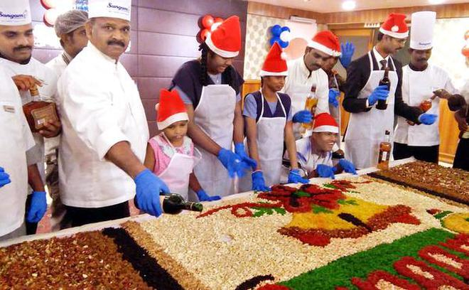 The right mix:Cake mixing ceremony in progress at Sangam Hotel in Tiruchi on Friday.SpecialArrangement