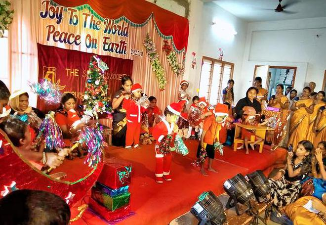 Children presenting a cultural programme during the Christmas celebrations at Spastics Society of Tiruchi on Friday