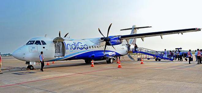 Passengers boarding the IndiGO flight at Tiruchi on Friday.HANDOUT