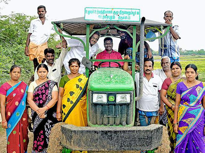 Collective bargaining:Farmer Producers' Groups members with their tractor bought at Nadarasapuram near Tiruverumbur in Tiruchi on Friday.M. Moorthy