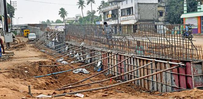 Residents are worried over slow pace of construction of the road overbridge.M. Srinath