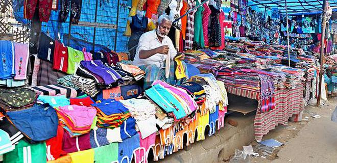 A street vendor displaying his wares on NSB Road in Tiruchi on Tuesday.M. Srinath